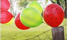 Draw black dots with sharpie on red balloons, and BAM! You've got yourself a watermelon! So cute!