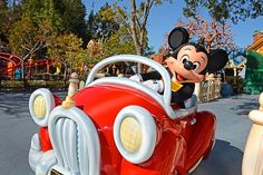 Mickey driving his red car...
