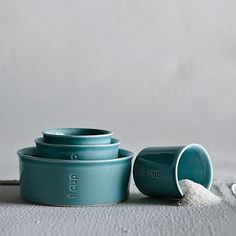 Measuring cups. The color in real life has more green and is so pretty. The perfect kitchen would be white and grey with accents of sea foam green, celadon, and this aqua with a window above the sink to look out through.