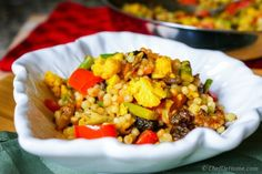 I love pearl couscous and whenever I can find some rainbow couscous in the store, I love serving curried couscous with lots of vegetables for dinner.Israeli Couscous also known as Ptitim or Pearl C...