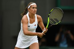 Monica Puig Photos - Monica Puig of Puerto Rico looks on during the Ladies Singles first round match gainst Johanna Konta of Great Britain on day two of the Wimbledon Lawn Tennis Championships at the All England Lawn Tennis and Croquet Club on June 28, 2016 in London, England. - Day Two: The Championships - Wimbledon 2016