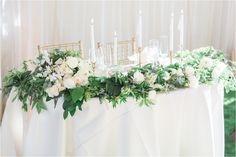 Sweetheart Table- i love the greenery and candles mixed with some flowers