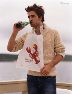 oh my...rob, the ocean and he's wearing the lobster bib!