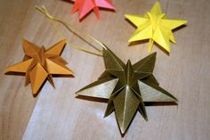 """Origami -  Etoile de Noël.  YouTube Video.  This star is by Endla Saar.  Diagrams are in Gay Merrill Gross's book """"Ornagami: for both 4-point and 5-point versions."""