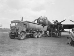 The Avro Lancaster B I PO*S/Sugar of Sqn RAAF refuels at RAF Hunsdon after completing its operation the previous evening against Bourg Leopold in Belgium on 12 May Aircraft Photos, Ww2 Aircraft, Military Aircraft, Fuel Truck, Old Lorries, Lancaster Bomber, Ww2 Planes, Battle Of Britain, Royal Air Force