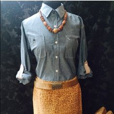 Drill Chambray Button Down Top, Sz M, NWT! Cute! Drill chambray light weight denim look button down top. Sleeve tabs to fasten rolled up sleeves. Sleeves can also be worn long. Contrasting placket color. Excellent! New with tags.  Size M. Can be worn with a lot, very versatile!  Wood necklace posted separately. Leopard suede skirt pictured (Sz 8) is also available for purchase, will post separately.   Please check out my other listings too. I bundle!  Drill Tops Button Down Shirts