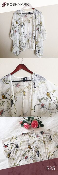 "🌺 Floral 🕊 bird print kimono cardigan Stunning 🌺 floral 🕊 bird kimono style open front cardigan. Size Small, and fits Small-Medium comfortably due to its open front kimono style cut. Measures: 25"" long// 17"" shoulder seam. Gently worn and in excellent condition. Please ask questions 💫 Forever 21 Sweaters Cardigans"