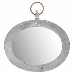 """Wood-framed wall mirror with a pocket watch-inspired silhouette.  Product: MirrorConstruction Material: Wood and mirrored glassColor: GrayDimensions: 19.5"""" H x 18"""" W x 1"""" D"""