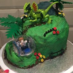 Lego Jurassic world cake. Just got to add the lava spilling from the volcano Lego Dinosaur, Dinosaur Birthday Cakes, Dinosaur Cake, Dinosaur Party, Park Birthday, Lego Birthday Party, Boy Birthday Parties, Jurassic World Cake, Jurassic Park