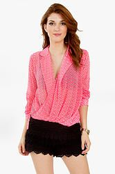 Legally Blonde Top: Neon pink collared top with a draped wrap front. Longer hem in the back. Pair it with boyfriend jeans and stiletto heels for a day shopping with the girls.