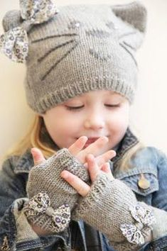 "Whispering Winds ""inspiration - looks like knit tube, sew closed, stitch off ear corners and embroider, add bow."", ""Precious Child ~ kitty hat and bow m"