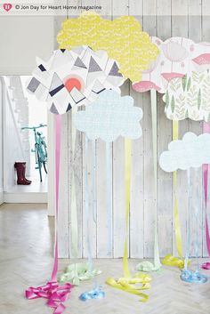 solid colored/patterned clouds with satin ribbon hanging down over flower pots for spring window