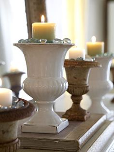 Garden urns as candle holders, good on the mantel in living room, bathroom, or if we ever tear down the kitchen wall...