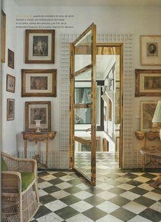 Brass door & checkerboard floor