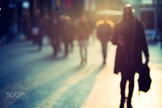 people walking in the street, abstract blurry von Alessandro Mattiacci