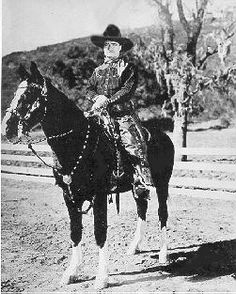 Tom Mix and his horse Tony........look at this horse tack! Edward H Bolin I believe.