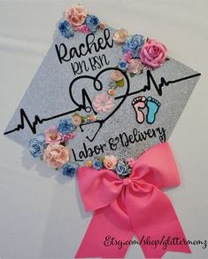 Nurse Graduation Cap Topper - Labor and Delivery - with flowers and bow Nursing Graduation Pictures, Nursing School Graduation, Graduation Diy, Grad Pics, Nursing Math, Nursing Gifts, Nursing Scrubs, Graduation Parties, Graduation Cap Toppers