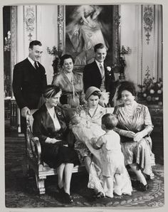 Prince Charles talking to his mother during christening photographs of his sister, Princess Anne. October 21, 1950.