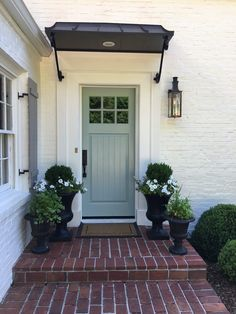 Front Door Paint Colors - Want a quick makeover? Paint your front door a different color. Here a pretty front door color ideas to improve your home's curb appeal and add more style! Front Door Awning, Front Door Planters, Front Door Entrance, Exterior Front Doors, Front Entry, Urn Planters, Black Planters, Door Entry, Entrance Ideas