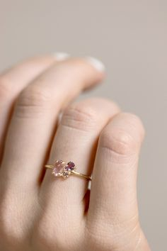 Pirouette Ring in Berry, pink sapphire and peach sapphire cluster ring prong set in 14k gold by Melanie Casey