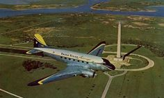 Trans Texas Airways Douglas DC-3 flying over the San Jacinto Monument in south Texas