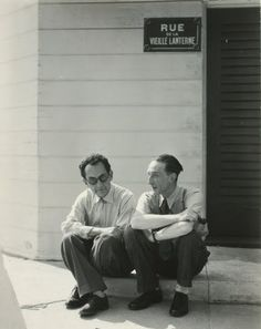 Man Ray and Marcel Duchamp Seated on a Curb, 1949