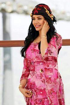 Loujain Omran in kurdish clothes