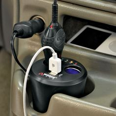 CUPHOLDER ADAPTER - Turn your car's cigarette lighter into 2 DC outlets & 2 USB ports.