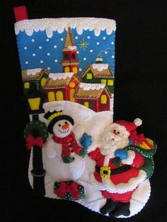 I hand cut and stitch my stockings with love and care. Each stocking takes over 40 hours to make and comes completely lined. All beads and sequins are also attached by hand. Stitched in a smoke free home. Please let me know in the message box the name of the person to be