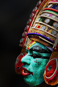 A dancer at the Attachamayam in Tripunithra, Kerala.......again reflecting the color in the Indian culture ,he looks like a cross between an avatar and something out of transformers ,,,but on a serious note , its very well carved and the color choices work fantastically