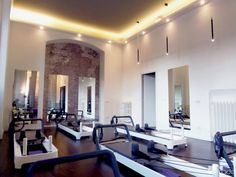 Interior Design Pilates Studio- Like Dark floors against white walls. Don't like those pendants but the LED behind the molding is an excellent effect