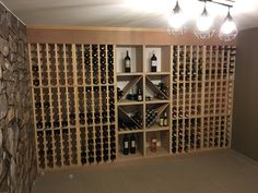 Casiers pour bouteilles, casier vin, cave à vin, rangement du vin, aménagement cave, casier bois, meuble en bois. Aménagement d'une magnifique cave particulière en Belgique dans laquelle nos casiers pour bouteilles en rangement unitaire (gamme Single) ont été intégrés dans une structure afin de créer une unité. Superbe cave !!! Merci d'avoir accepté de partager ces photos avec nous !
