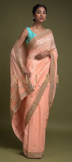 Buy Online from the link below. We ship worldwide (Free Shipping over US$100)  Click Anywhere to Tag  Salmon Peach Saree In Cotton Silk With Zardozi And Sequins Embroidered Floral Border And Buttis Online - Kalki Fashion  Salmon peach saree in cotton silk adorned with zardozi and sequins embroidered floral border.Further enhanced with embroidered floral buttis.