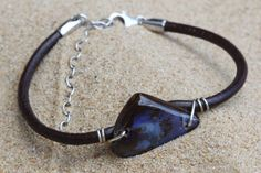 Boulder Opal Bracelet, Solid Australian Opal fixed to Brown Genuine Leather Band with Sterling Silver Wire and Adjustable Silver Chain Clasp. #jewelry #jewelrymaking #jewelrydesign #boho #bohochic #gypsy #bohostyle #bohojewelry #opal #stone #gemstone #pearl #raw #ornament #bolo #necklace #earring #ring #bolo #bracelet