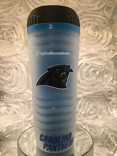 A personal favorite from my Etsy shop https://www.etsy.com/listing/478454599/carolina-panthers-16oz-travel-mug