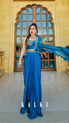 Seaside Blue Dhoti Skirt And Crop Top With An Attached Ruffle Pallu Online - Kalki Fashion Water Blue, Deep Water, Blue Drapes, Jaisalmer, Organza Flowers, Forts, Cutwork, Corset, Ruffles