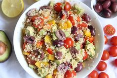 Tossed quinoa + olive salad with avocado and tomato | Liezl Jayne