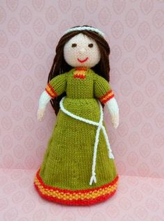Doll Knitting Pattern - Elvina - A Medieval Doll - 1086 by Joanna Marshall Elvina - A Knitted English Romanesque Lady - 1086. Elvina is 28cms tall. It was unusual for a Saxon lady to own land but I have decided to give an Anglo Saxon name to Elvina, meaning 'a friend of the elves'. Ladies wore simple dresses during this time. The colours most often used were: green, light blue and pink. The very long flowing sleeves were not seen until later in this Medieval period, but they were evident in…