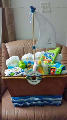 Baby Shower Boat Gift Basket - Made by LadyM Sweets, Flowers and creations Miami FL Baby Shower Camo, Baby Hamper, Baby Shower Gift Basket, Baby Baskets, Baby Shower Gifts, Gift Baskets, Baby Shower Parties, Baby Shower Themes, Baby Showers