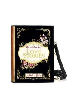 'Love Stories' Book Cover Clutch is a whimsical design featuring hand embroidered details on a vintage book cover style. This is a very unique clutch bag! The Downton Book Cover Clutch Bag has plenty of space for your phone, wallet, and other essentials. The zip pocket in the center provides secure space for your cards and loose change. The interior pocket is the perfect place for your travel card or keys so they are always easy to locate. This stylish bag has a faux leather (PU) spine with…