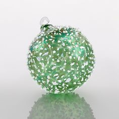Limelight by Gabriel Bloodworth: Art Glass Ornament available exclusively at www.artfulhome.com A glamorous globe of emerald blown glass is enticingly frosted with ivory frit.