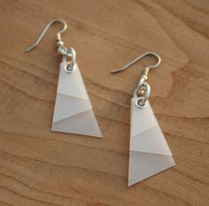Recycled Plastic Milk Jug Earrings. You could combine different colored plastic from various types of bottles. How cool would a rainbow color sequence look?