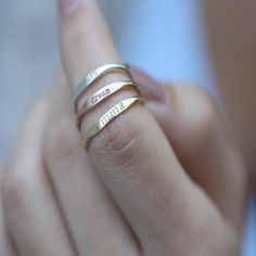Custom skinny name ring by CaitlynMinimalist on Etsy. Personalized stacking ring in sterling silver, rose gold or gold. These rings make great bridesmaids or new mom gifts (afflink) Stackable Name Rings, Skinny, Topas, Custom Name Necklace, Custom Necklaces, Name Bracelet, Fork Bracelet, Rings For Girls, Necklaces