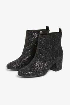<p>To the dance floor, stat. A glittery little pair of ankle boots with the perfect heels and a little zip to them.</p> <p>colour: <em>Disco ball<br /