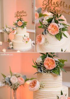Wedding cake with custom cake topper and floral arrangement   Caroline & Evan Photography