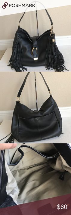 """G.I.L.I Leather Stirrup Hobo Bag with Fringe In good condition. Inside zipper handle missing last pictures shows. Overall in great condition. Fringe detail, goldtone hardware, top strap, stirrup magnetic closure, signature removable tassel, back slip pocket with snap closure Signature tan lined interior, two front slip pockets, back zip pocket Measures approximately 12-1/2""""W x 12""""H x 4""""D with a 13"""" strap drop; weighs approximately 1 lb, 14 oz G.I.L.I  Bags Hobos"""