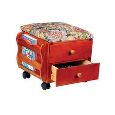 This rolling ottoman brings you both comfort and extra storage. It's cushioned floral tapestry top lifts to give you easy access to the storage space below. A handy magazine rack holds newspapers, ...