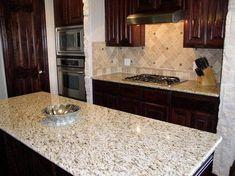 Giallo Ornamental Granite Countertops are a light granite color that can best be… Backsplash With Dark Cabinets, Granite Backsplash, Dark Kitchen Cabinets, Kitchen Tops, Granite Kitchen, Kitchen Redo, Kitchen Countertops, Kitchen Backsplash, New Kitchen