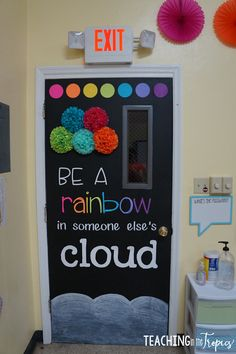 "elementary classroom decor ""Be a rainbow in someone else's cloud."" LOVE this classroom door decoration. A perfect accompaniment to a rainbow unit with elementary aged children! Classroom Bulletin Boards, New Classroom, Classroom Design, Classroom Displays, Art Classroom Door, March Bulletin Board Ideas, Bulletin Board Ideas For Teachers, Rainbow Bulletin Boards, Classroom Display Boards"