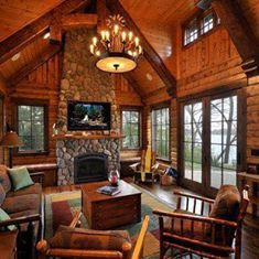 Rustic cabin at the lake house! Love that fireplace.